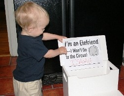 "Child Holding ""I'm an Elefriend -- I Won't Go to the Circus!"" Sign"