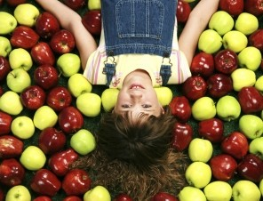 Girl Laying On Apples