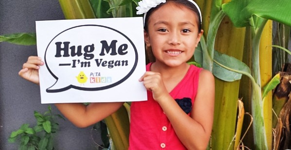 Hug a Vegan Day Kid With Sign