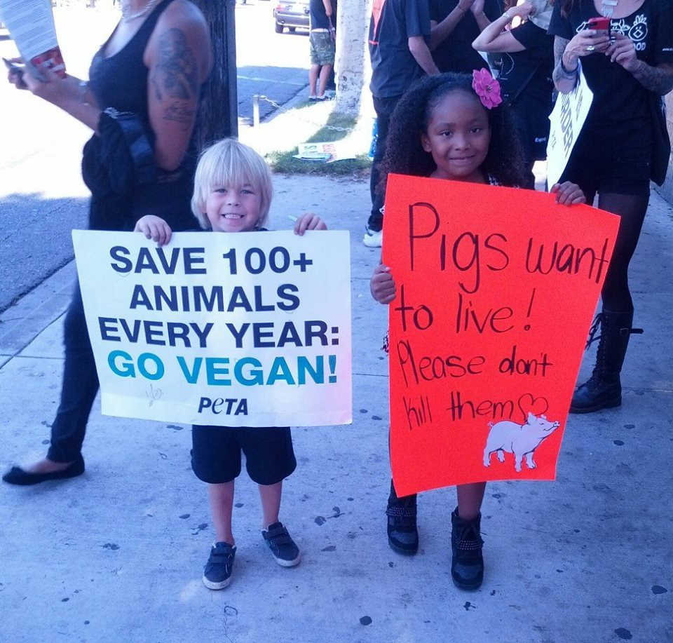 Genesis and friend advocate for veganism.