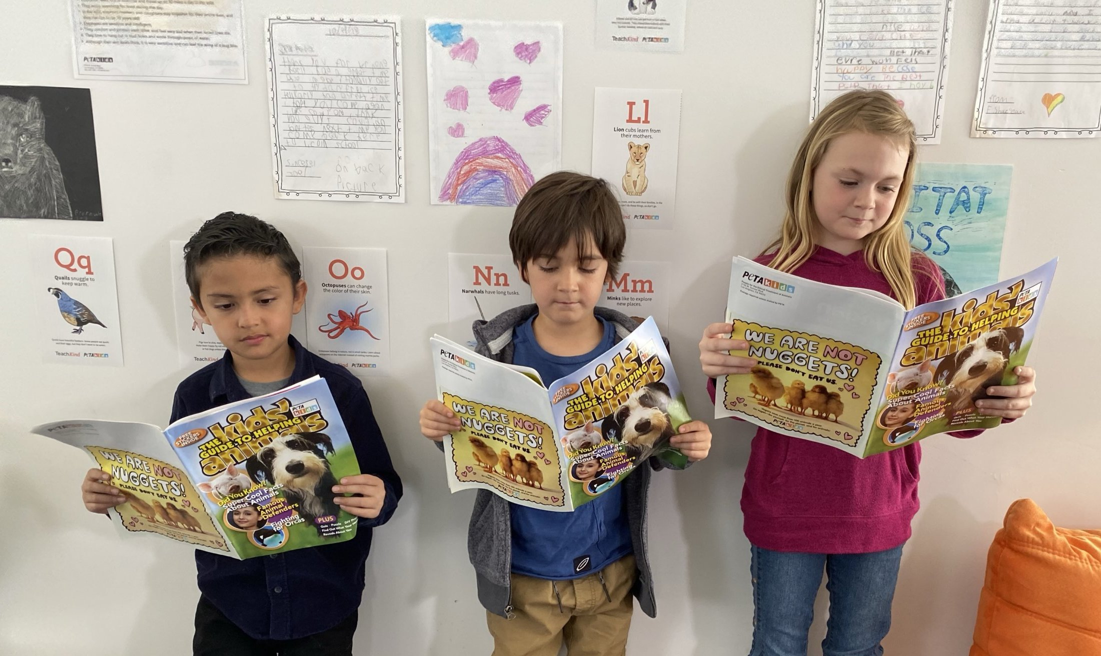 kids reading a kids guide to helping animals