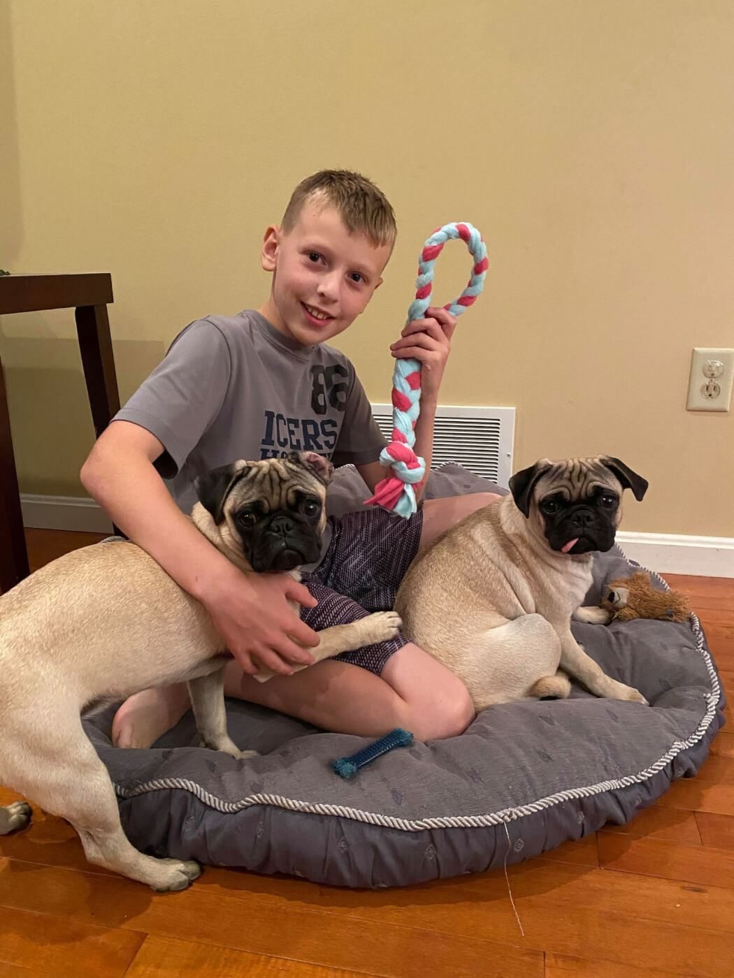 Ryan and his two dogs playing with a pup tug